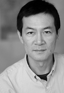 A black and white image of an asian man