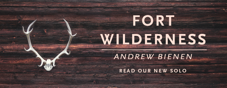 """A piece of wood with antlers attached and the text """"Fort Wilderness by Andrew Bienen"""""""