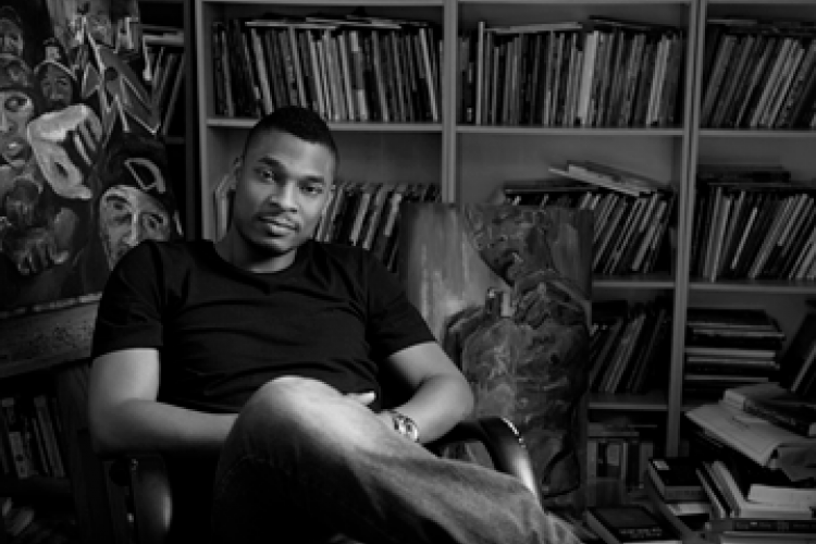 Terrance Hayes, black-and-white photo, sitting in library