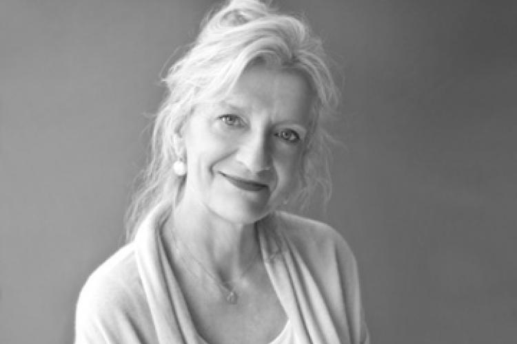 Black and white image of a white woman wearing a cardigan