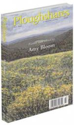 A journal cover of a field of yellow flowers overlooking multiple green mountains