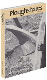 A journal cover with a black and white photograph if a wooden tool stuck in the dirt